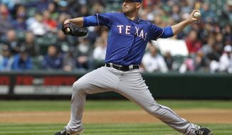 Texas Rangers starting pitcher Matt Harrison throws against the Seattle Mariners, Sunday, April 27, 2014, in the first inning of a baseball game in Seattle. (AP Photo/Ted S. Warren)