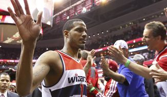 Washington Wizards forward Trevor Ariza (1) walks off the court after Game 4 of an opening-round NBA basketball playoff series against the Chicago Bulls in Washington, Sunday, April 27, 2014. The Wizards defeated the Bulls 98-89. (AP Photo/Alex Brandon)