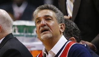 Washington Wizards owner Ted Leonsis, while sitting on the bench wearing Wizards forward Nene's jersey, watches the second half against the Chicago Bulls in Game 4 of an opening-round NBA basketball playoff series in Washington, Sunday, April 27, 2014. Nene is serving a one game suspension. (AP Photo/Alex Brandon) **FILE**