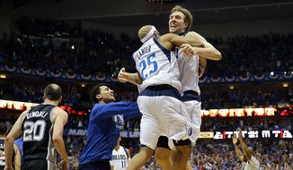 Dallas Mavericks forward Dirk Nowitzki (41) and guard Vince Carter (25) celebrate Carter's game-winning three-point basket during Game 3 in the first round of the NBA basketball playoffs against the San Antonio Spurs in Dallas, Saturday, April 26, 2014. The Mavericks won 109-108. (AP Photo/The Dallas Morning News, Tom Fox) MANDATORY CREDIT; NO SALES; MAGAZINES OUT; TV OUT; INTERNET USE BY AP MEMBERS ONLY