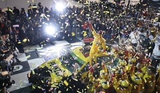 Joey Logano celebrates in Victory Lane after winning the NASCAR Sprint Cup auto race at Richmond International Raceway in Richmond, Va., Saturday April 26, 2014. (AP Photo/Richmond Times-Dispatch, Dean Hoffmeyer)