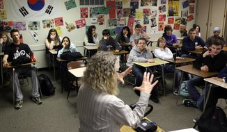 In this April 18, 2014 file photo, students crowd into a classroom at North Thurston High School in Olympia, Wash. (AP Photo/Ted S. Warren) **FILE**