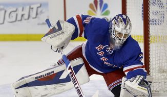 New York Rangers goalie Henrik Lundqvist makes a save during the first period in Game 5 of an NHL hockey first-round playoff series against the Philadelphia Flyers, Sunday, April 27, 2014, in New York. (AP Photo/Seth Wenig)