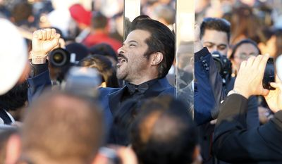 Indian film star Anil Kapoor walks the green carpet as he arrives for the 15th annual International Indian Film Awards on Saturday, April 26, 2014, in Tampa, Fla. (AP Photo/Brian Blanco)