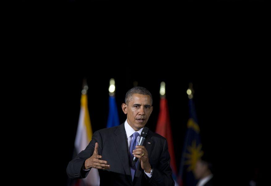 U.S. President Barack Obama speaks during a town hall meeting at Malaya University in Kuala Lumpur, Malaysia, Sunday, April 27, 2014. The last American president to visit Malaysia was Lyndon B. Johnson in 1966. (AP Photo/Carolyn Kaster)