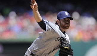 San Diego Padres starting pitcher Ian Kennedy delivers against the Washington Nationals during the first inning of a baseball game on Sunday, April 27, 2014, in Washington. (AP Photo/Nick Wass)