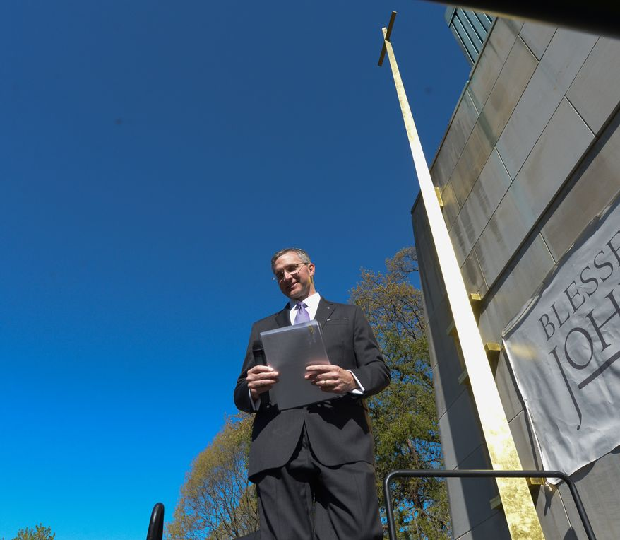 Patrick Kelly, Executive Director of the Pope John Paul II National Shrine,  is about offer remarks at the unveiling ceremony of the renamed shrine dedicated to Pope John Paul II to reflect the sainthood bestowed upon him on Sunday, April 27 in Northeast. Khalid Naji-Allah Special to The Washington Times