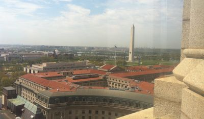 The view of the Washington monument and beyond from the observation deck of the Old Post Office Pavilion, which is closing Thursday for two years as part of a renovation that will turn the building into a luxury hotel. (Andrea Noble/The Washington Times)