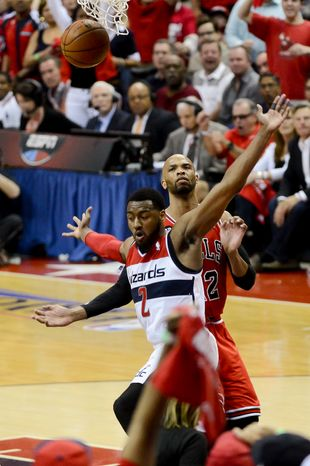 Washington Wizards guard John Wall (2) celebrates after stealing a ball and dunking in the first half as the Chicago Bulls play the Washington Wizards in game 4 of the first round of the playoffs at the Verizon Center, Washington, D.C., Sunday, April 27, 2014. (Andrew Harnik/The Washington Times)