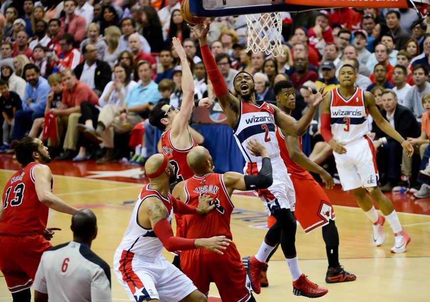 Washington Wizards guard John Wall (2) goes up for shot as the Chicago Bulls play the Washington Wizards in game 4 of the first round of the playoffs at the Verizon Center, Washington, D.C., Sunday, April 27, 2014. (Andrew Harnik/The Washington Times)