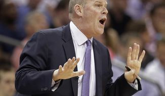 Charlotte Bobcats coach Steve Clifford talks to his players during the first half in Game 4 of an opening-round NBA basketball playoff series against the Miami Heat in Charlotte, N.C., Monday, April 28, 2014. (AP Photo/Chuck Burton)