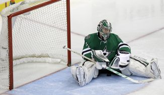 Dallas Stars goalie Kari Lehtonen (32) sits after Anaheim Ducks Nick Bonino scored the game winning overtime goal of Game 6 to win the first-round NHL hockey playoff series in Dallas, Sunday, April 27, 2014. (AP Photo/LM Otero)