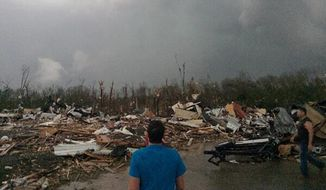 This photo provided by James Bryant shows tornado damage, Sunday, April 27, 2014, in Mayflower, Ark. (AP Photo/Courtesy of James Bryant)