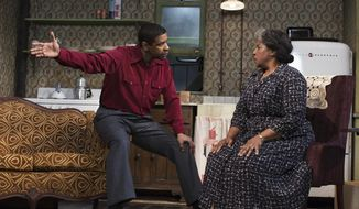 "** FILE ** This file image released by Philip Rinaldi Publicity shows Denzel Washington, left, and LaTanya Richardson Jackson during a performance of ""A Raisin in the Sun,"" at the Ethel Barrymore Theatre in New York. (AP Photo/Philip Rinaldi Publicity, Brigitte Lacombe, File)"
