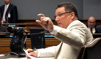 Rep. John Schroder, R-Covington, explains his proposed changes to next year's budget during a meeting of the House Appropriations Committee on Monday, April 28, 2014, in Baton Rouge, La. The committee reworked Louisiana Gov. Bobby Jindal's spending plan for the 2014-15 budget year. (AP Photo/Melinda Deslatte)