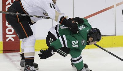 Dallas Stars center Cody Eakin (20) and Anaheim Ducks center Ryan Getzlaf (15) skate for the puck during the second period of Game 6 of a first-round NHL hockey playoff series in Dallas, Sunday, April 27, 2014. (AP Photo/LM Otero)
