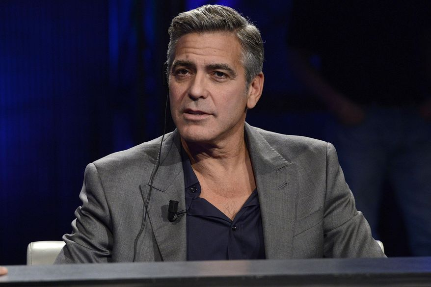 """FILE - This Sunday, Feb. 9, 2014 file photo shows American actor George Clooney interviewed by Fabio Fazio during the Italian State RAI TV program """"Che Tempo che Fa"""", in Milan, Italy. Hollywood's most eligible bachelor may be getting hitched. A London law firm on Monday April 28, 2014, has congratulated one of its lawyers on her engagement to George Clooney. (AP Photo/Giuseppe Aresu, File)"""