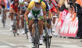Australia's Simon Gerrans of the Orica Greenedge team sprints to win the 100th edition of the Belgian cycling classic and UCI World Tour race Liege-Bastogne-Liege, in Ans, Belgium, Sunday, April 27, 2014. Spain's Alejandro Valverde of the Movistar team became second, Poland's Michal Kwiatowski of the Omega Pharma team was third. (AP Photo/Yves Logghe)