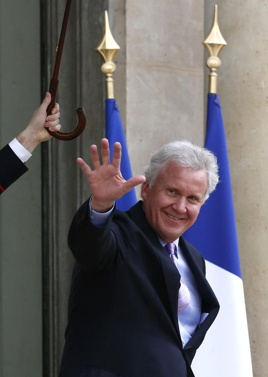 "U.S. giant General Electric Co. CEO Jeffrey R. Immelt leaves the Elysee Palace after meeting with French President Francois Hollande in Paris, Monday, April 28, 2014.  Hollande met Sunday with top members of the government to discuss Alstom, hours after the Economy Minister Arnaud Montebourg warned the engineering company not to pursue a ""precipitous"" tie-up with U.S. giant General Electric Co., saying that France's national interest is at stake in a potential sale. (AP Photo/Michel Euler)"