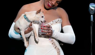 "This photo provided by Jeffrey Richards Associates shows Audra McDonald as Billie Holiday in ""Lady Day at Emerson's Bar & Grill"" while holding Roxie. (AP Photo/Jeffrey Richards Associates, Evgenia Eliseeva)"