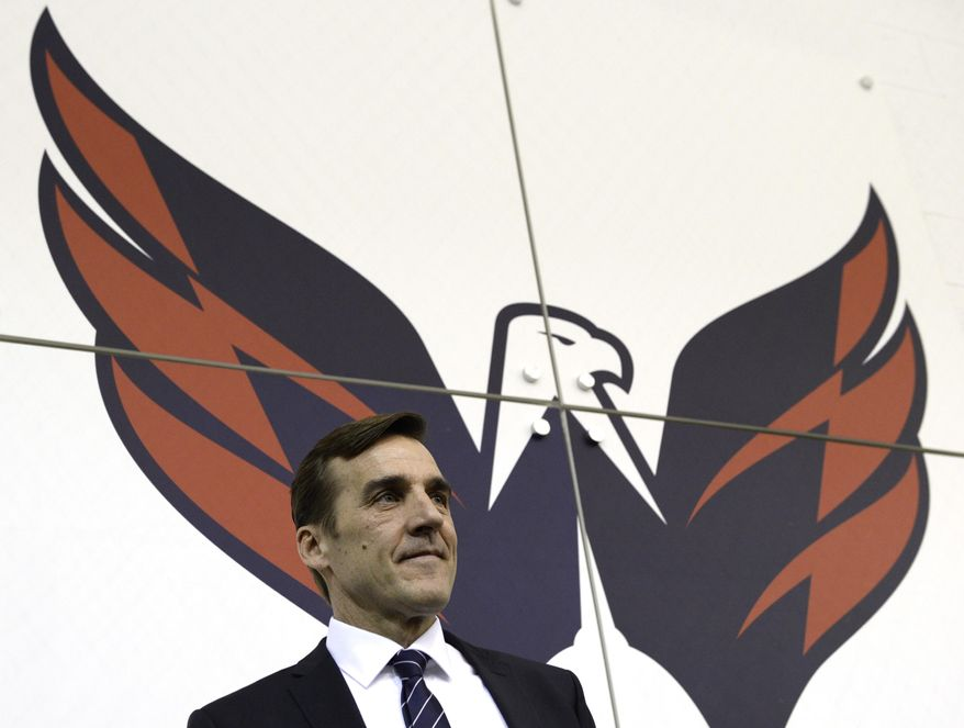 Washington Capitals former general manager George McPhee walks away from the podium after a news conference in Arlington, Va., Monday, April 28, 2014. McPhee and coach Adam Oates lost their jobs with the Washington Capitals after the team failed to make the playoffs for the first time since 2007. (AP Photo)