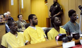 FILE - In this Monday, April 21, 2014, file photo, from left to right, Wonzey Saffold, James Davis, Latrez Cummings and Bruce Wimbush Jr., sit before Judge Thomas Jackson, at Frank Murphy Hall of Justice, in Detroit. The four men, accused of attacking a suburban motorist who accidentally struck a 10-year-old boy on Detroit's east side, are scheduled to appear in Wayne County Circuit Court, Monday, April 28, 2014, on assault with intent to murder charges. (AP Photo/Detroit News, David Coates, File)