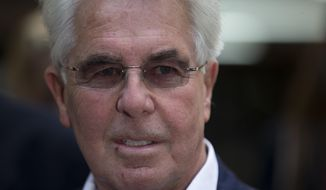 British public relations guru Max Clifford pauses to pose for members of the media as he leaves his trial at Southwark Crown Court in London, Monday, April 28, 2014. Leading British public relations agent Clifford on Monday was found guilty of eight counts of indecent assault on women and girls. (AP Photo/Matt Dunham)