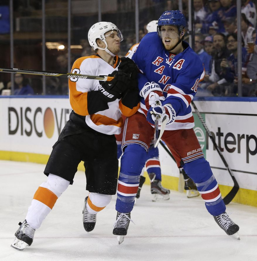 Philadelphia Flyers' Brayden Schenn, left, checks New York Rangers' Marc Staal during the first period in Game 5 of an NHL hockey first-round playoff series, Sunday, April 27, 2014, in New York. (AP Photo/Seth Wenig)