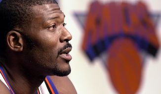**FILE** New York Knicks forward Larry Johnson speaks with a reporter during Knicks media day at their training facilities in Purchase, New York, Monday, Oct. 1, 2001. (AP Photo/Stephen Chernin)