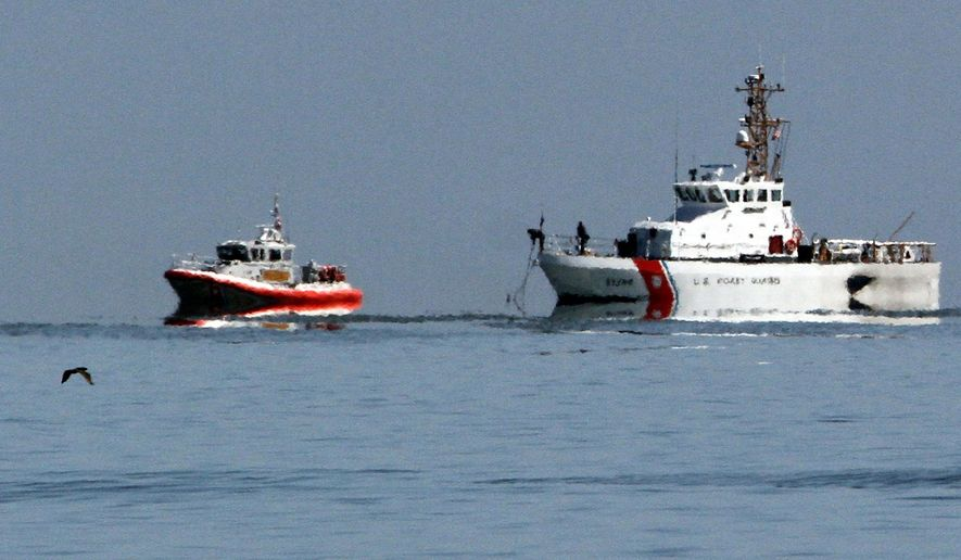 Coast Guard vessels continue to search the waters of San Pablo Bay on Monday, April 28, 2014, in Richmond, Calif. A federal transportation safety official arrived Monday in Northern California to investigate a collision between two small planes that sent one crashing into the San Francisco Bay. The collision occurred Sunday near the Richmond-San Rafael Bridge and involved a single-engine Cessna 210 and a single-engine Hawker Sea Fury TMK 20. (AP Photo/Bay Area News Group, Laura A. Oda)
