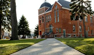The historic city hall in Marine City, Mich., shown here on April 18, 2014, is awaiting funds for restoration. The Historical Society of Marine City and Friends of City Hall are forming a committee to raise funds for restorations. (AP Photo/The Port Huron Times Herald, Jeffrey Smith) NO SALES