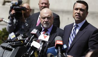 U.S. Rep. Michael Grimm, right, speaks to the media outside of federal court in New York, Monday, April 28, 2014. The Staten Island Republican was arrested earlier in the day and pleaded not guilty to a 20-count federal indictment that includes charges of mail fraud, wire fraud and tax fraud. (AP Photo/Seth Wenig)