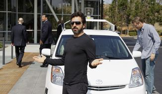 FILE - In this Sept. 25, 2012, file photo, Google co-founder Sergey Brin gestures after riding in a driverless car with officials, to a bill signing for driverless cars at Google headquarters in Mountain View, Calif. Google engineers say they have turned a corner in their pursuit of creating a car that can drive itself. Test cars have been able to navigate freeways comfortably for a few years. On Monday, April 28, 2014, Google said the cars can now negotiate thousands of urban situations that would have stumped them a year or two ago.  (AP Photo/Eric Risberg, File)