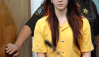 Samantha Grigg enters the Clinton County Circuit Court in St. Johns, Mich., Monday, April 28, 2014, where she pleading guilty to manslaughter in the death of Michigan State University student Dustyn Frolka, saying the victim jumped from a moving SUV to escape being attacked and was left along the side of an interstate. Grigg told the court that she drove Frolka, 19, to ATMs before two others beat and robbed him, the Lansing State Journal and MLive.com reported. Frolka was found unconscious Feb. 15 on Interstate 69 in Clinton County's Bath Township, near Lansing.  (AP Photo/The State Journal, Greg DeRuiter) NO SALES
