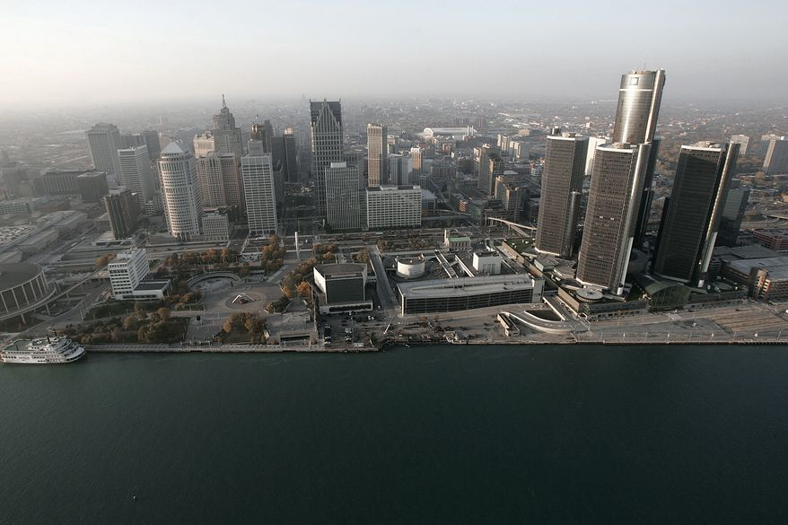 """FILE - In this Nov. 2, 2005 file photo, the Detroit skyline is shown along the Detroit River. Detroit has reached a tentative deal with unions that represent thousands of employees in the bankrupt city. Mediators announced Monday, April 28, 2014 that the city and the Coalition of Detroit Unions have agreed in principle on the """"major aspects"""" of a five-year collective bargaining agreement.(AP Photo/Paul Sancya, File)"""