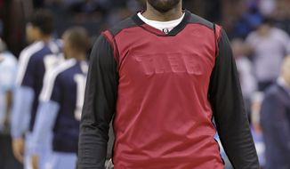 Miami Heat's LeBron James wears his warm-up jacket inside out before Game 4 of the Heat's opening-round NBA basketball playoff series against the Charlotte Bobcats in Charlotte, N.C., Monday, April 28, 2014. (AP Photo/Chuck Burton)