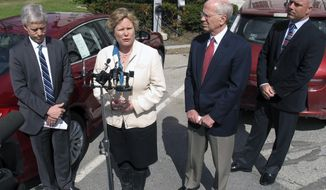 Montpelier Mayor John Hollar, left, U.S. Rep. Peter Welch, second from right, and Dan Keene, right, owner of Lamoille Valley Ford, listen as Karen Glitman, second from left, of the Vermont Energy Investment Corp., speaks about the importance of electric vehicles, Monday, April 28, 2014, in Montpelier, Vt. Welch said he is planning to introduce legislation in Congress to increase the tax credit for the purchase of electric vehicles to up to $10,000 as a way to make it easier for people to buy electric cars. (AP Photo/Wilson Ring)