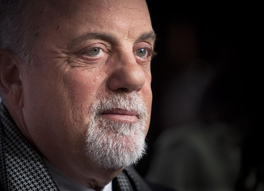 "** FILE ** This Oct. 15, 2013, file photo shows Billy Joel at the Elton John AIDS Foundation's 12th Annual ""An Enduring Vision"" benefit gala at Cipriani Wall Street in New York. (Photo by Carlo Allegri/Invision/AP, File)"
