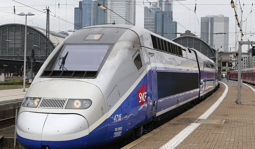A French TGV train leaves the main train station in Frankfurt, Germany, Monday, April 28, 2014. German engineering giant Siemens AG says it is prepared to discuss a tie-up with its French rival Alstom which manufactures the country's groundbreaking high-speed TGV trains. (AP Photo/Michael Probst)