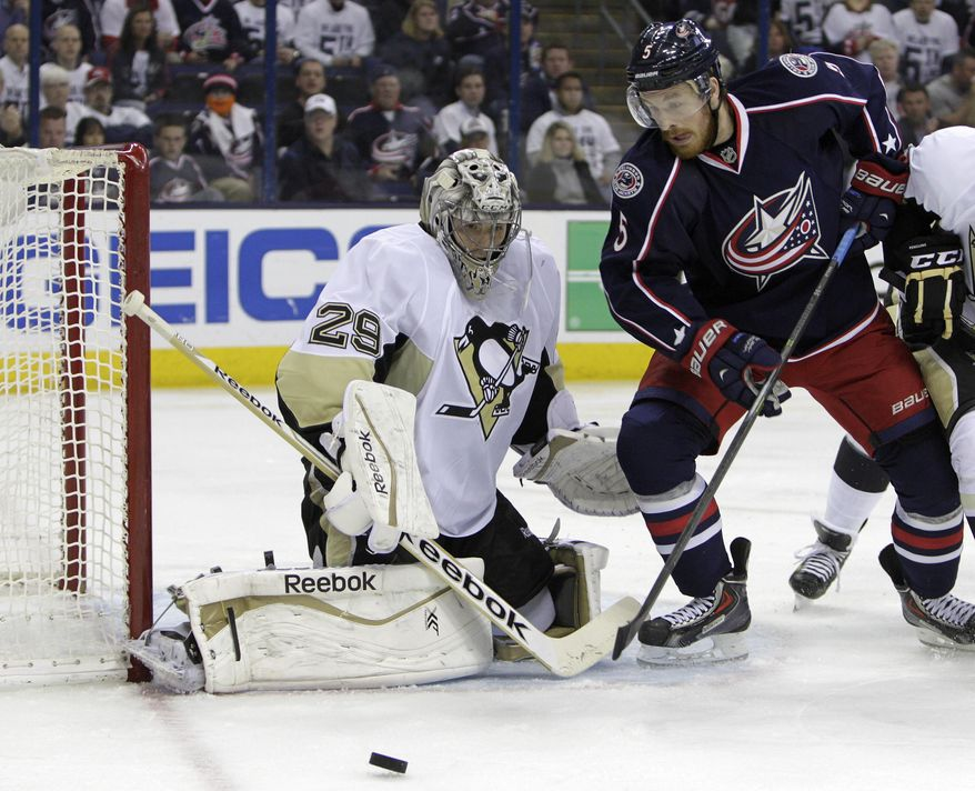 Pittsburgh Penguins' Marc-Andre Fleury, left, makes a save against Columbus Blue Jackets' Jack Skille during the second period of Game 6 of a first-round NHL playoff hockey series Monday, April 28, 2014, in Columbus, Ohio. (AP Photo/Jay LaPrete)