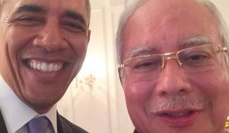 President Barack Obama posed for a selfie with the Malaysia's Prime Minister, Najib Razak.