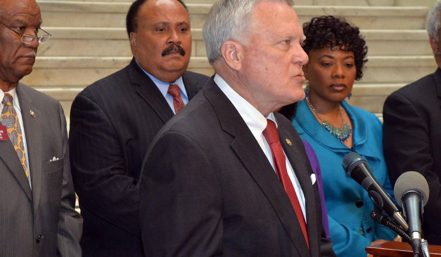 Governor Nathan Deal makes remarks as State Rep Calvin Smyre, Martin Luther King III and Bernice King listen at the state Capitol Tuesday, April 29, 2014. Tuesday marks the last day the governor can sign bills into law.   (AP Photo/Atlanta Journal-Constitution, Kent D. Johnson)  MARIETTA DAILY OUT; GWINNETT DAILY POST OUT; LOCAL TV OUT; WXIA-TV OUT; WGCL-TV OUT