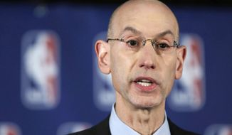 NBA Commissioner Adam Silver addresses the media during a news conference, in New York, Tuesday, April 29, 2014. Silver announced that he is banning Los Angeles Clipper owner Donald Sterling for life from the Clippers organization over racist comments in a recording. (AP Photo/Richard Drew)