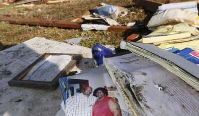 An undated photograph of Ruth Bennett, right, a child care owner, who was killed at her facility by Monday's tornado, dries outside the remains of the building in Louisville, Miss.,Tuesday, April 29, 2014.  Bennett, died while clutching a child as a tornado wiped her business off its foundation, strewing it into the backyard of a neighboring home. (AP Photo/Rogelio V. Solis)