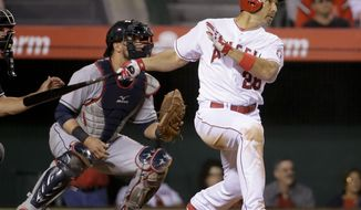 Los Angeles Angels' Raul Ibanez watches his RBI-triple in front of Cleveland Indians catcher Yan Gomes during the eighth inning of a baseball game in Anaheim, Calif., Monday, April 28, 2014. (AP Photo/Chris Carlson)