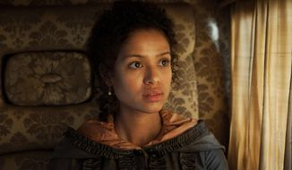 "This photo released by Fox Searchlight shows Gugu Mbatha-Raw, as Dido Elizabeth Belle, in a scene from the film, ""Belle."" (AP Photo/Fox Searchlight, David Appleby)"