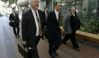 ADDS ID'S, UPDATES CAPTION INFO - Apple attorneys Harold McElhinny, left, William Lee, center, and Rachel Krevans walk with others to a federal courthouse in San Jose, Calif., Monday, April 28, 2014. A federal court has delayed by a day closing arguments in the Apple and Samsung trial because of an appeals court ruling in another case on a related patent issue. Dueling expert witnesses were called back to the stand Monday in a San Jose federal courtroom to discuss whether the ruling in a legal dispute between Apple and Motorola has any effect on the Apple and Samsung trial. Lawyers will now deliver closing arguments Tuesday. (AP Photo/Jeff Chiu)