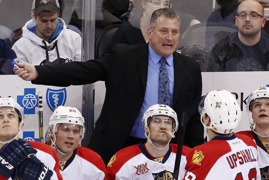 FILE - In this Jan. 20, 2014, file photo, Florida Panthers head coach Peter Horachek gives instructions during an NHL hockey game between the Pittsburgh Penguins and the Panthers in Pittsburgh. The Panthers have parted ways with Horachek, said Panthers general manager Dale Tallon, Tuesday, April 29, 2014, saying the dismissal was effective immediately. (AP Photo/Gene J. Puskar, File)