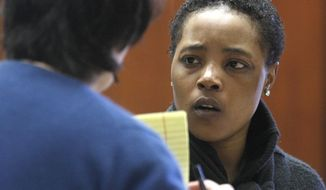 Defense Attorney Susan Freedman, left, questions her client Haniyyah Barnes, Tuesday, April 29, 2014, in Newark, N.J. Barnes admitted killing her neighbor's 2-year-old Shih Tzu named Honey Bey by throwing the dog into traffic during an argument over a parking space in August 2011. The dog was struck by a vehicle and killed. (AP Photo/The Star-Ledger, Patti Sapone, Pool)