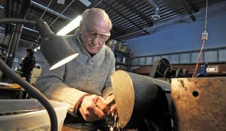ADVANCED FOR RELEASE SATURDAY, MAY 3, 2014 Jack Zwickey, owner of Zwickey Archery in North St. Paul, Minn., hand grinds arrowheads in his shop on Thursday, April 17, 2014. Zwickey's father started the company in 1938.  (AP Photo/Pioneer Press, Scott Takushi)